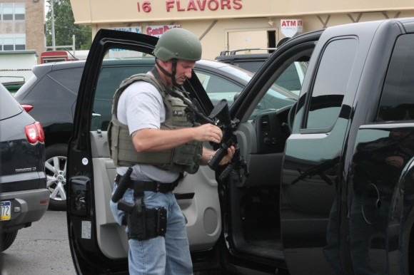 A federal Marshal preparing for the raid in the parking lot for Christine's Twisty Treats. Credit: Tom Sofield/LevittownNow.com