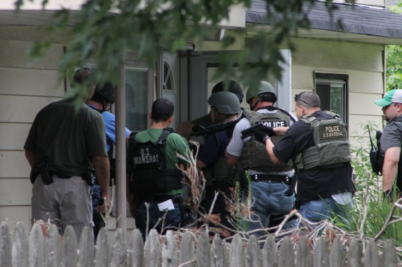 US Marshals move in of 10 Border Rock Road in Levittown to take down one of the state's most wanted men on Wednesday afternoon. Credit: Tom Sofield/LevittownNow.com