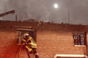 A firefighter works to douse flames in the area where the fire started.  Credit: Tom Sofield/LevittownNow.com