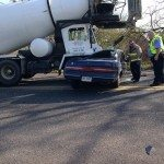 Firefighters Cut Victim from Car After Concrete Truck Crash